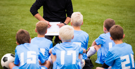 soccer football coach tactic strategy speech. kids listening coach strategy speech.