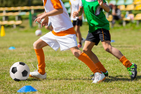 Football soccer match for children. kids playing soccer game tournament