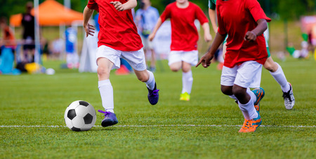 Boys playing soccer football match. Sport competition.