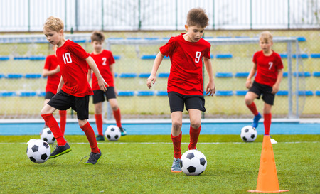 Photo for Boys training soccer skills on grass field. Football school class for children - Royalty Free Image