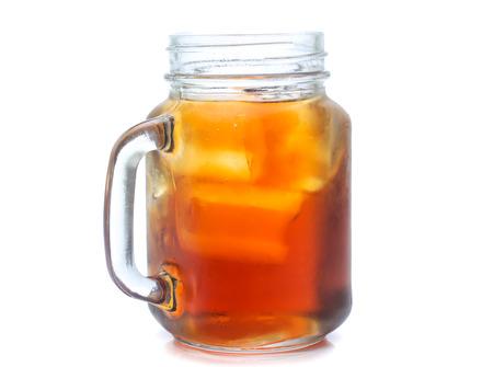 Foto de jar glass of iced tea with lemons  isolated on a white background - Imagen libre de derechos