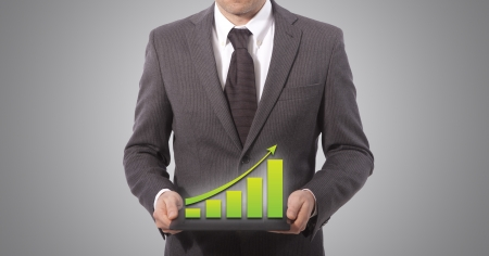 business man with touch screen graph on a tablet, grey background