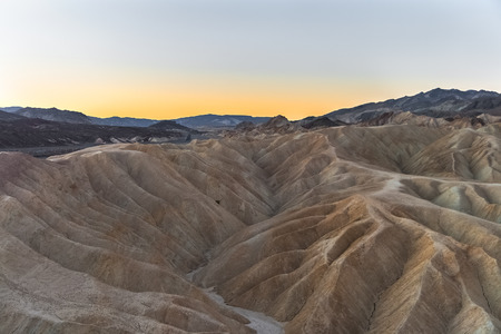 Photo for Sunrise on the famous mudstone and claystone of Zabriskie Point, Death Valley National Park, California. - Royalty Free Image