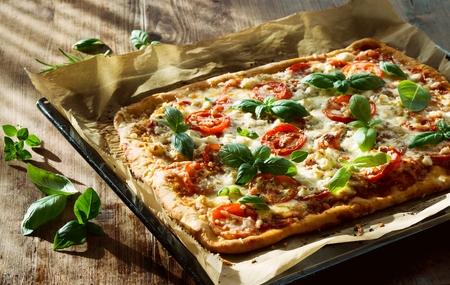 Photo pour Homemade Italian Pizza on baking sheet - image libre de droit