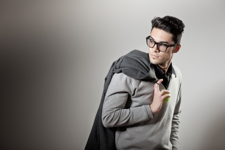 Photo pour attractive man dressed casual wearing glasses - studio shot, copy space - image libre de droit