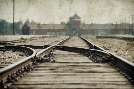 Photo pour Main gate and railroad of Auschwitz Birkenau. Effect with grunge background, fake old photo - image libre de droit