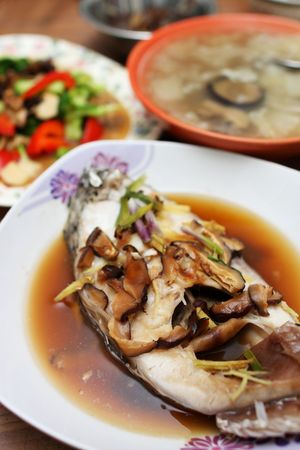 Close up of mushroom fish with other dishes.