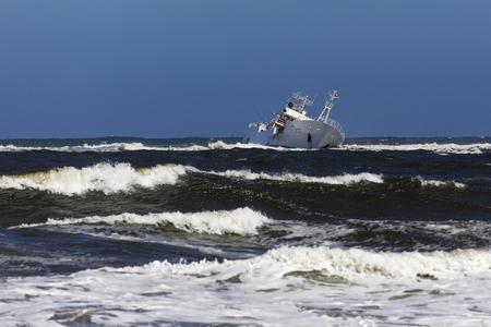 Foto de Skeleton Coast, Namibia - August 10, 2018: Shipwreck in the sea - Imagen libre de derechos
