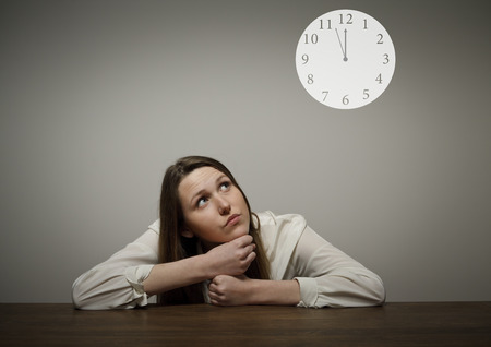 Thinking Girl full of doubts and hesitation Time concept Several minutes to twelve