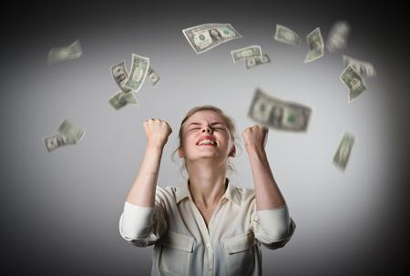 Foto de Rejoicing. Young slim woman and falling dollar banknotes. Success, currency and lottery concept. - Imagen libre de derechos