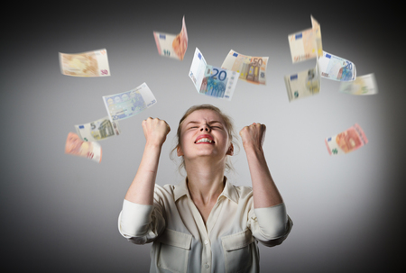 Foto de Rejoicing. Young slim woman and falling Euro banknotes. Success, currency and lottery concept. - Imagen libre de derechos