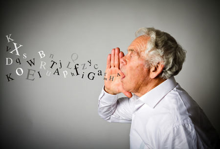 Photo pour Old man in white is screaming at something. Letters. - image libre de droit
