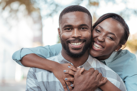Foto per Affectionate young African couple standing outside on a sunny day - Immagine Royalty Free