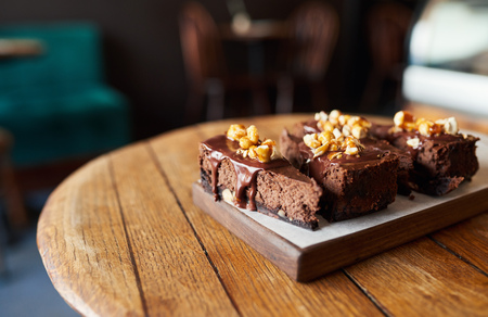 Photo for Four slices of chocolate cake sitting on a bakery table - Royalty Free Image