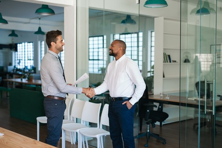 Photo for Manager shaking hands with a job applicant after an interview - Royalty Free Image
