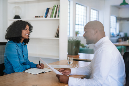 Photo for Smiling manager interviewing a potential employee in her office - Royalty Free Image