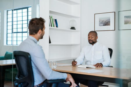 Photo for Two businessmen having a meeting together in an office - Royalty Free Image