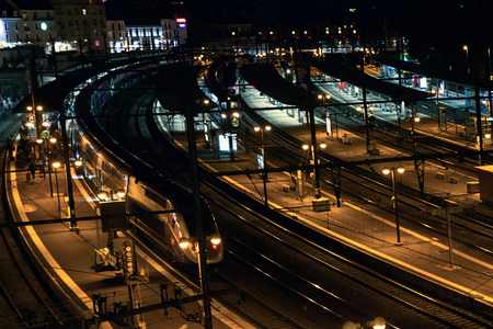 Foto per Large terminal railway passenger traffic in evening hours. Maintenance of high-speed trains, suburban train - Immagine Royalty Free