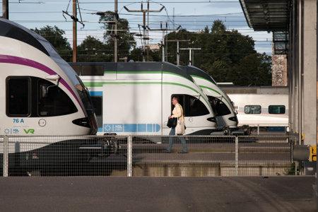 Foto per Helsinki, Finland - August 22, 2017: High-speed intercity trains on the passenger platform - Immagine Royalty Free