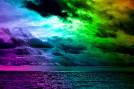 Foto de Seascape, sea view. Disturbing dramatic sky above winter sea. Contrasting colors of weather and sunset over sea. Torn Cumulus clouds in wind before storm, prethunderstorm sky, nebulosity - Imagen libre de derechos