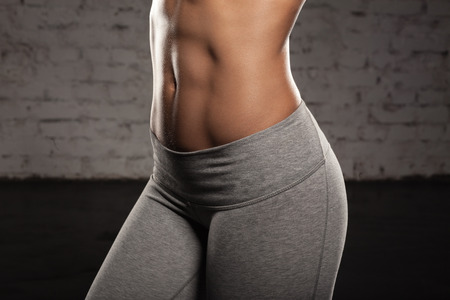 Photo for Fitness female woman with muscular body, do her workout, abs, abdominals - Royalty Free Image