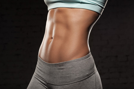 Photo pour Fitness female woman with muscular body, do her workout, abs, abdominals - image libre de droit