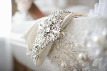 Photo pour Beautiful wedding dress decoration close up - image libre de droit