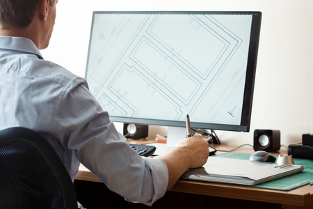 Foto de Graphic designer using digital tablet and computer in office or home - Imagen libre de derechos