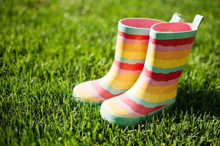 Striped rain boots on green grass