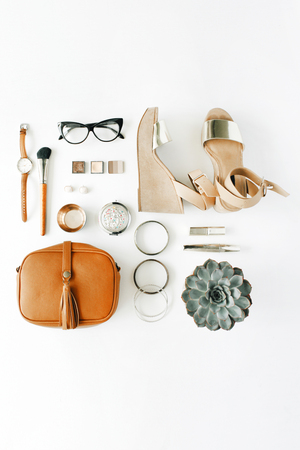 Photo for flat lay feminini accessories collage with purse, watch, glasses, bracelet, lipstick, sandals, mascara, brushes on white background. - Royalty Free Image