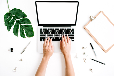 Photo for Workspace with hands typing on laptop with blank screen. Flat lay, top view - Royalty Free Image