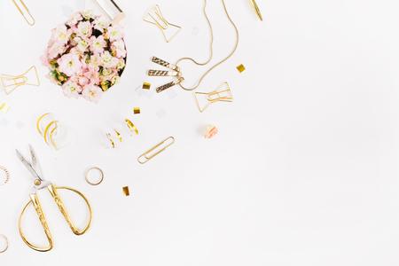 Photo pour Beauty blog background. Gold style feminine accessories. Golden tinsel, scissors, pen, rings, necklace, bracelet on white background. Flat lay, top view. - image libre de droit
