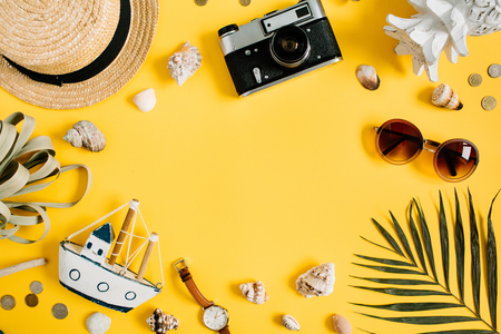 Foto de Flat lay traveler accessories on yellow background with blank space for text. Top view travel or vacation concept. Summer background. - Imagen libre de derechos
