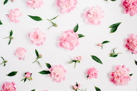 Photo pour Flower pattern of pink peony flowers, branches, leaves and petals on white background. Flat lay, top view. Peony flower texture. - image libre de droit