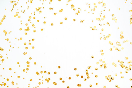 Photo pour Mock up frame with space for text made of golden confetti tinsel on white background. Flat lay, top view. Minimal background. - image libre de droit