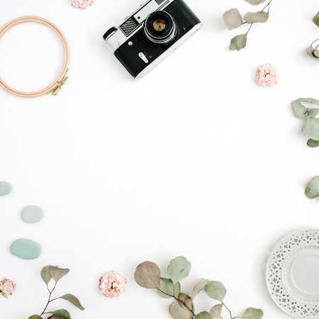 Photo for Flat lay border frame with retro camera, eucalyptus branches, plate on white background. Top view artist background with space for text. - Royalty Free Image