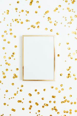 Photo pour Photo frame mock up with space for text and golden confetti on white background. Flat lay, top view. Minimal background. - image libre de droit