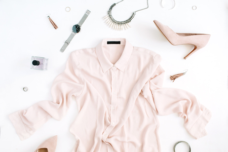 Foto de Women modern fashion clothes and accessories. Flat lay female casual style look with pastel blouse, high heels, watch, perfume. Top view. - Imagen libre de derechos