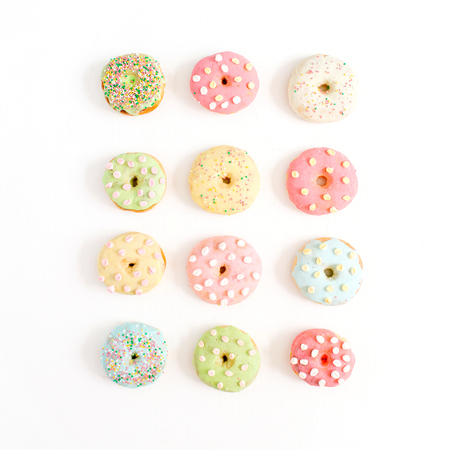 Photo for Colorful donuts on white background. Flat lay, top view minimal pattern. - Royalty Free Image