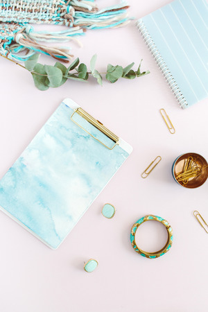 Foto de Flat lay home office desk. Female workspace with clipboard, diary, stationery on pale pink background. Top view feminine concept. - Imagen libre de derechos