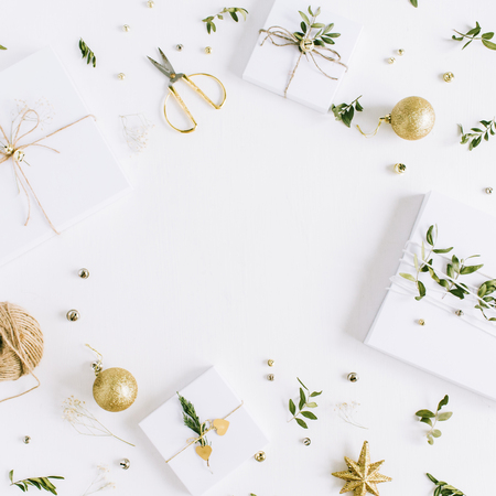 Photo for Frame of handmade Christmas gift boxes and festive decoration on white background. Flat lay, top view holiday composition. - Royalty Free Image