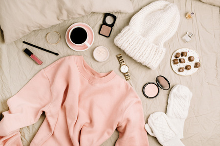 Photo pour Female fashion look with stylish clothes and accessories. Lifestyle flat lay, top view composition with sweatshirt, cosmetics and coffee. - image libre de droit