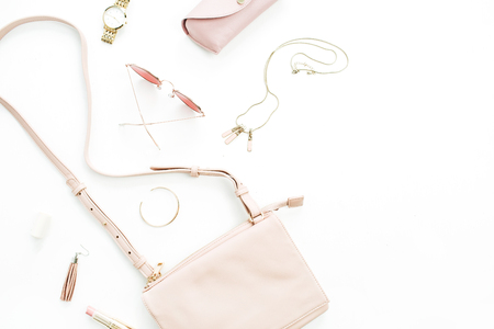 Foto de Woman fashion trendy stylish pastel pink accessories set on white background. Flat lay, top view. - Imagen libre de derechos