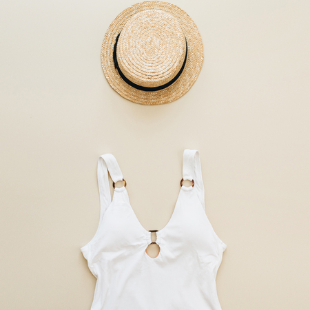 Photo pour Flat lay summer fashion composition. Women's swimsuit, straw on pastel beige background. Flat lay, top view minimal beach concept. - image libre de droit