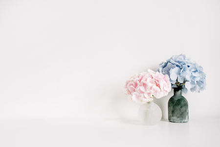 Photo for Pink and blue hydrangea flower bouquets on white background. Minimal interior design floral concept. - Royalty Free Image