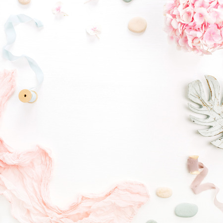 Photo for Round frame of hydrangea flower bouquet, eucalyptus branch, pastel pink blanket, monstera leaf plate on white background. Flat lay, top view mockup with space for text. - Royalty Free Image