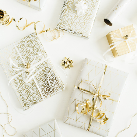 Photo for Golden gift boxes, decorations on white background. Flat lay, top view Christmas, New Year holiday gifts packaging concept. - Royalty Free Image