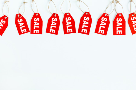 Photo for Black Friday sales discount composition. Red tags with word SALE on white background. Flat lay, top view. - Royalty Free Image