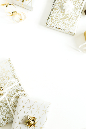 Foto de Border frame of Christmas, New Year holiday composition with golden gift boxes, decorations on white background. Flat lay, top view of gifts packaging. - Imagen libre de derechos