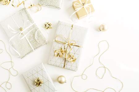 Photo for Christmas, New Year holiday composition with golden gift boxes, decorations on white background. Flat lay, top view of gifts packaging. - Royalty Free Image